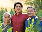 photo of Shailesh and his parents among the myrtle
