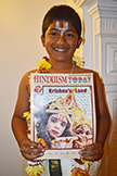 London boy holding Hinduism Today