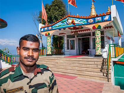 Soldier-priest in front of Hanuman Tok temple